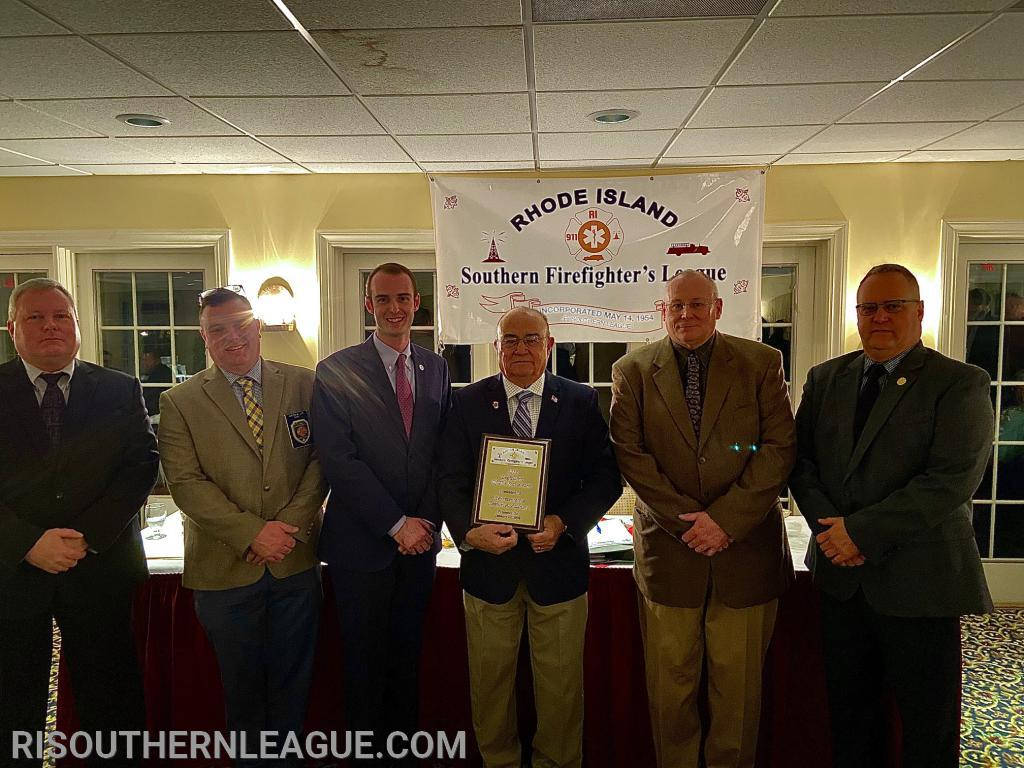 State Rep. Sam Azzinaro poses with the League's Officers after being named the Legislator of the Year.  Pictured L-R: Vice President Bob Peacock, Treasurer Justin Lee, Secretary Chris Koretski, Rep. Azzinaro, President Nate Barrington, and Director Scott Barber.