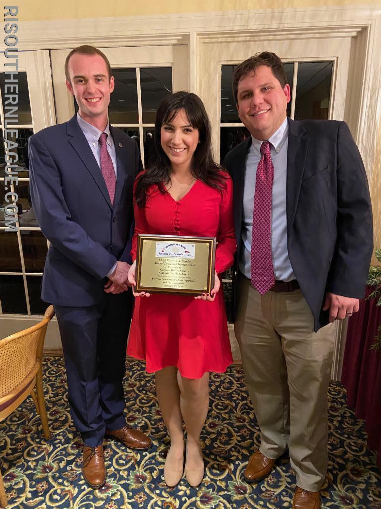 Lieutenant Chris Koretski, Secretary of the Southern League presented the award to Captains Katie & Travis Serra