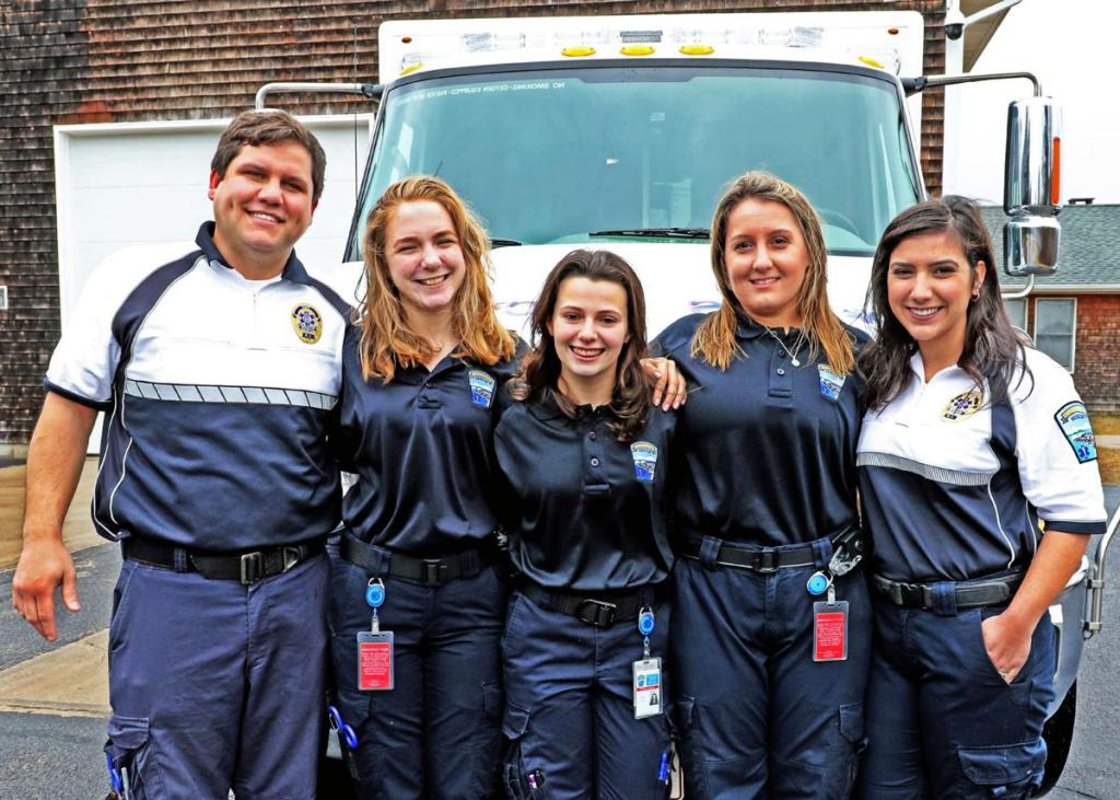 Captains Katie & Travis Serra pose with members of the Charlestown Ambulance Rescue Service. The Westerly Sun Photo.