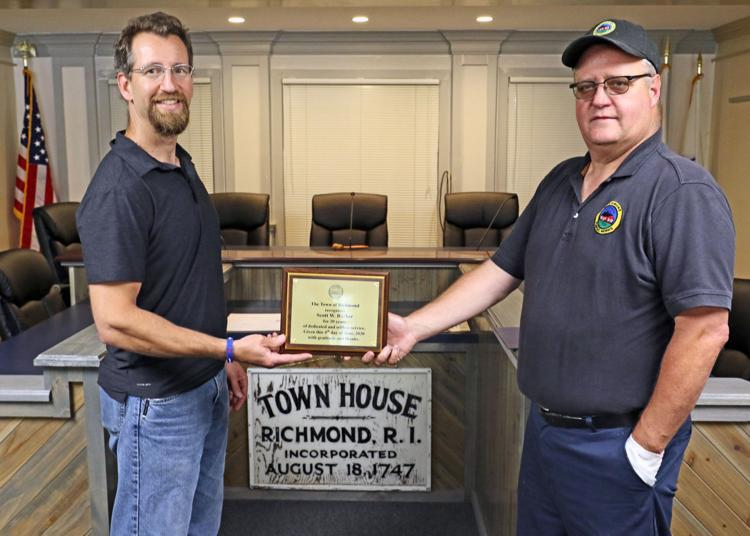 Richmond Town Council President Rich Nassaney, left, presents a plaque to DPW director and fire chief Scott Barber noting his 20 years of service to the town on Thursday. | Harold Hanka, The Westerly Sun