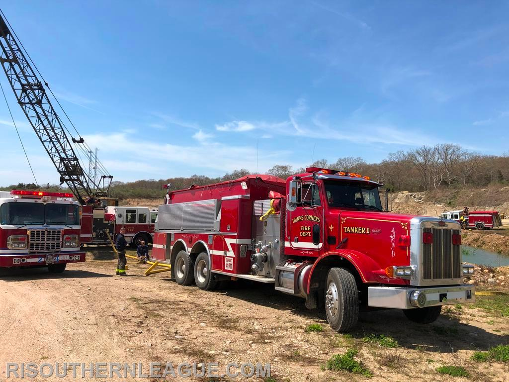 Dunn's Corners Tanker 1 and UFD Tanker 24 await water at the fill site run by the Charlestown FD
