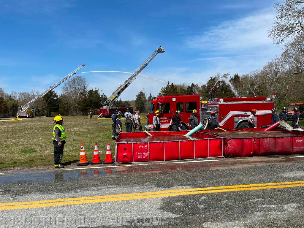 Watch Hill Ladder 104, Kingston Ladder 2 and Misquamicut Engine 203 operate at the dump site during the live drill.